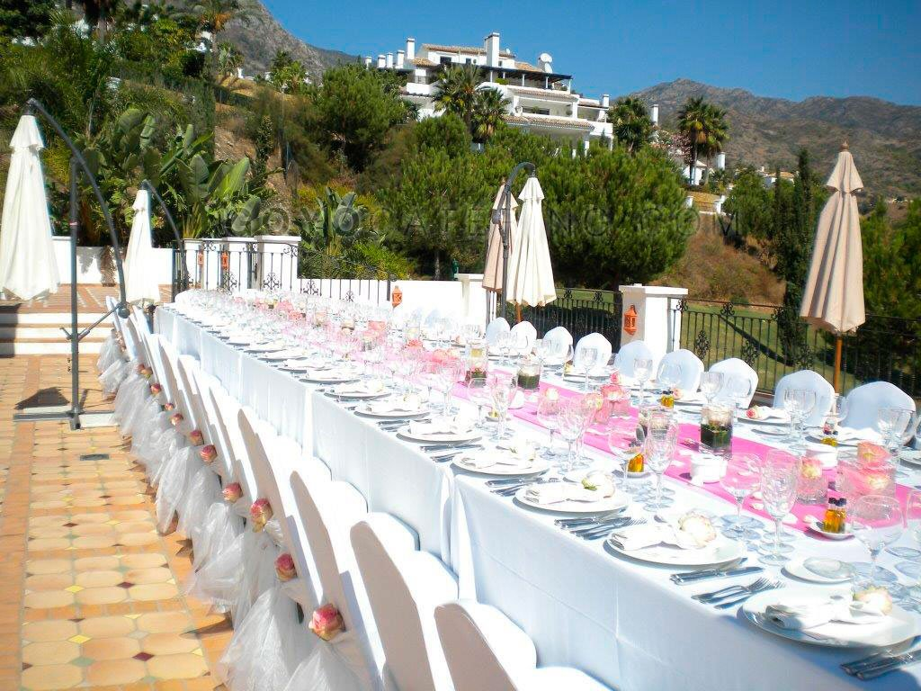 Table set up in white and pink. | Goyo Catering & Imperial table set up at an event. - Goyo Catering